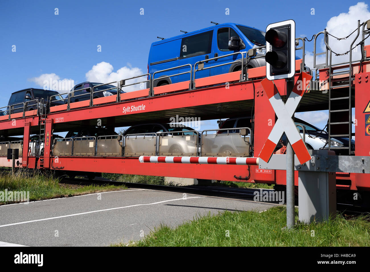 Railroad crossing, car train, Sylt Shuttle, connecting the island of Sylt with the mainland, Sylt, North Frisian - Stock Image
