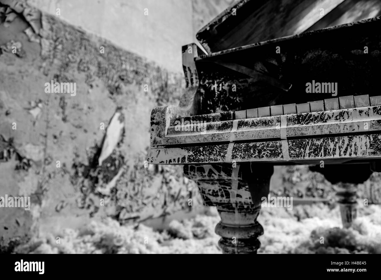 an old forgotten piano in the remedial sites of Beelitz - Stock Image