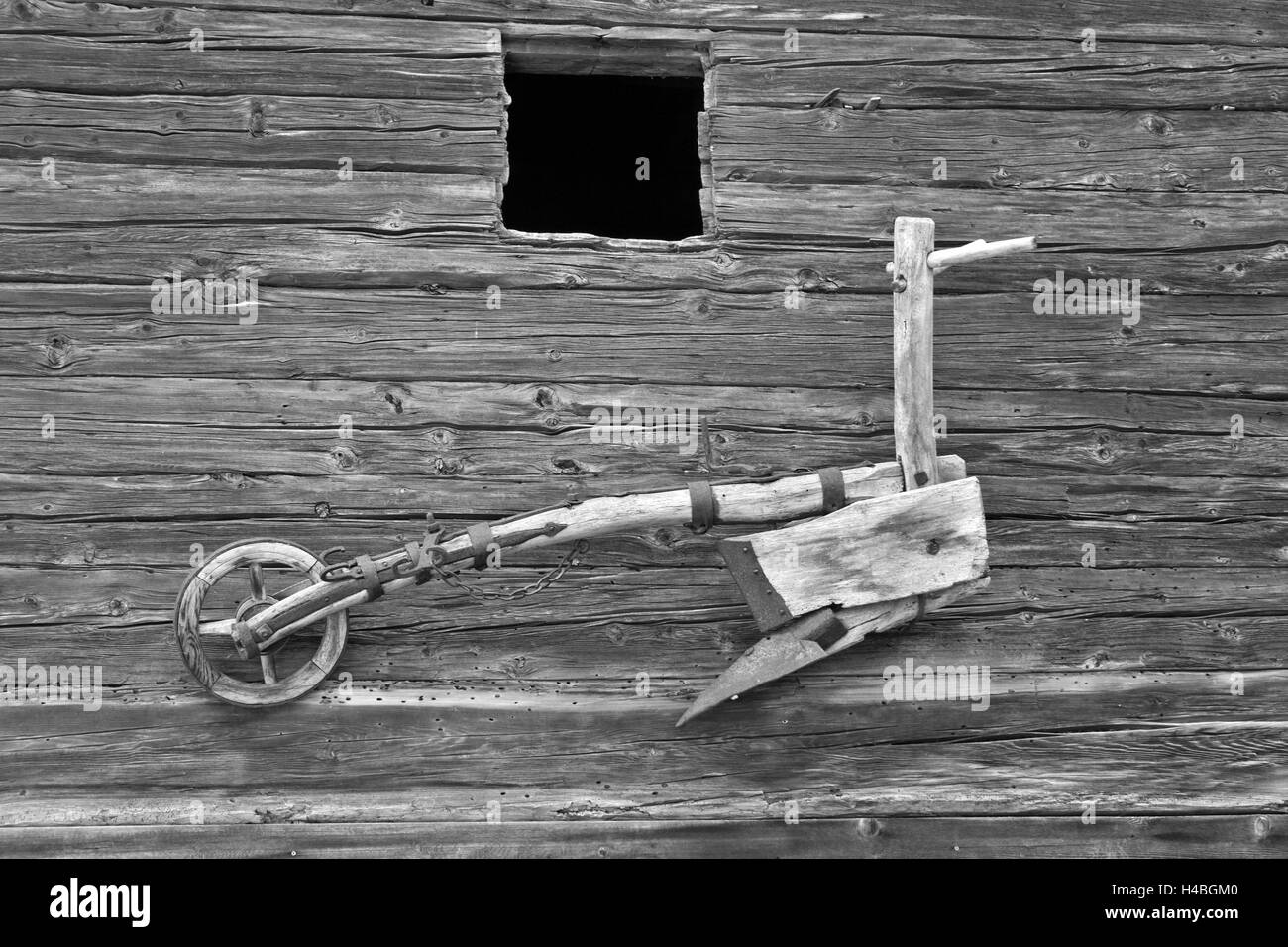 old wooden plough on beam wall - Stock Image