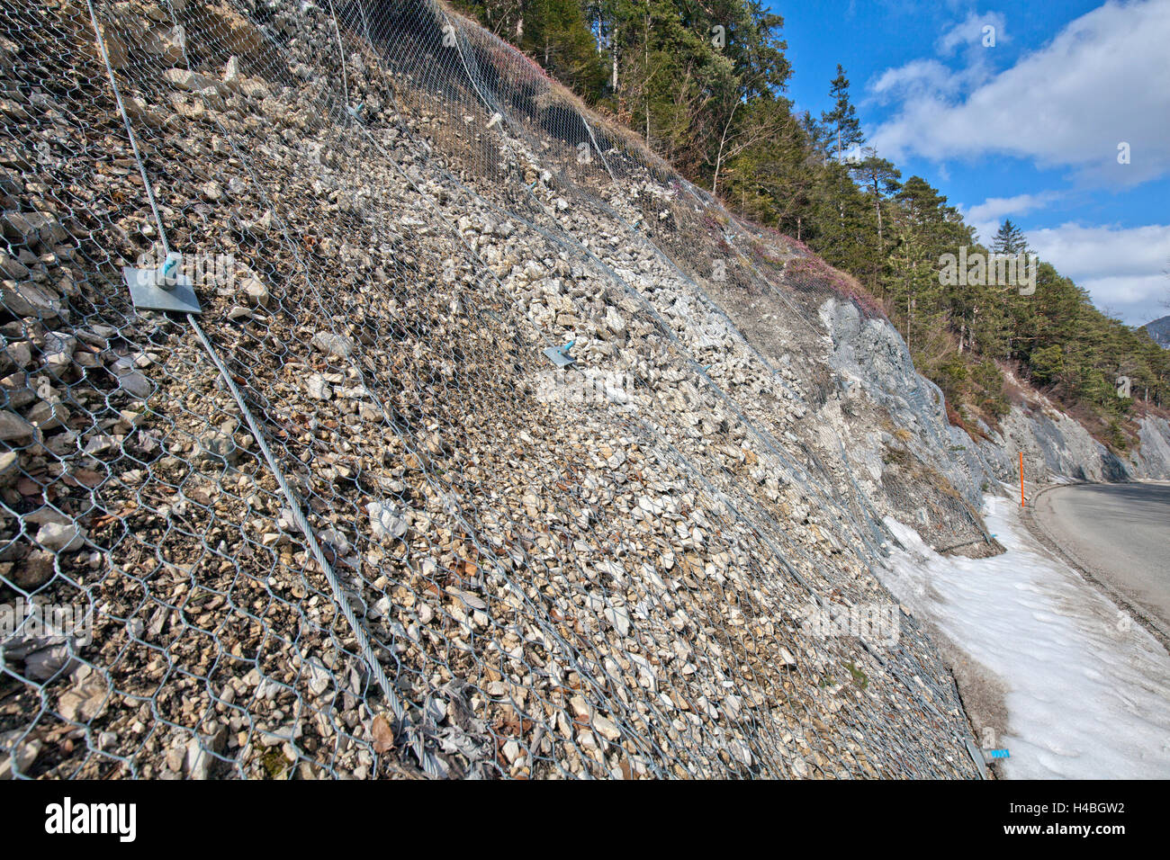 Rockfall protection on mountain road - Stock Image