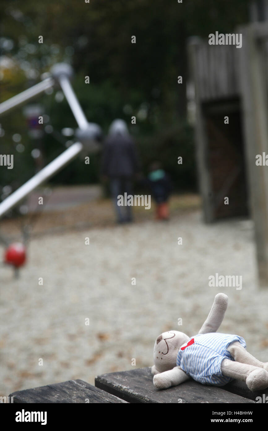 Children's playground, teddy bear, lonely, forgotten, - Stock Image