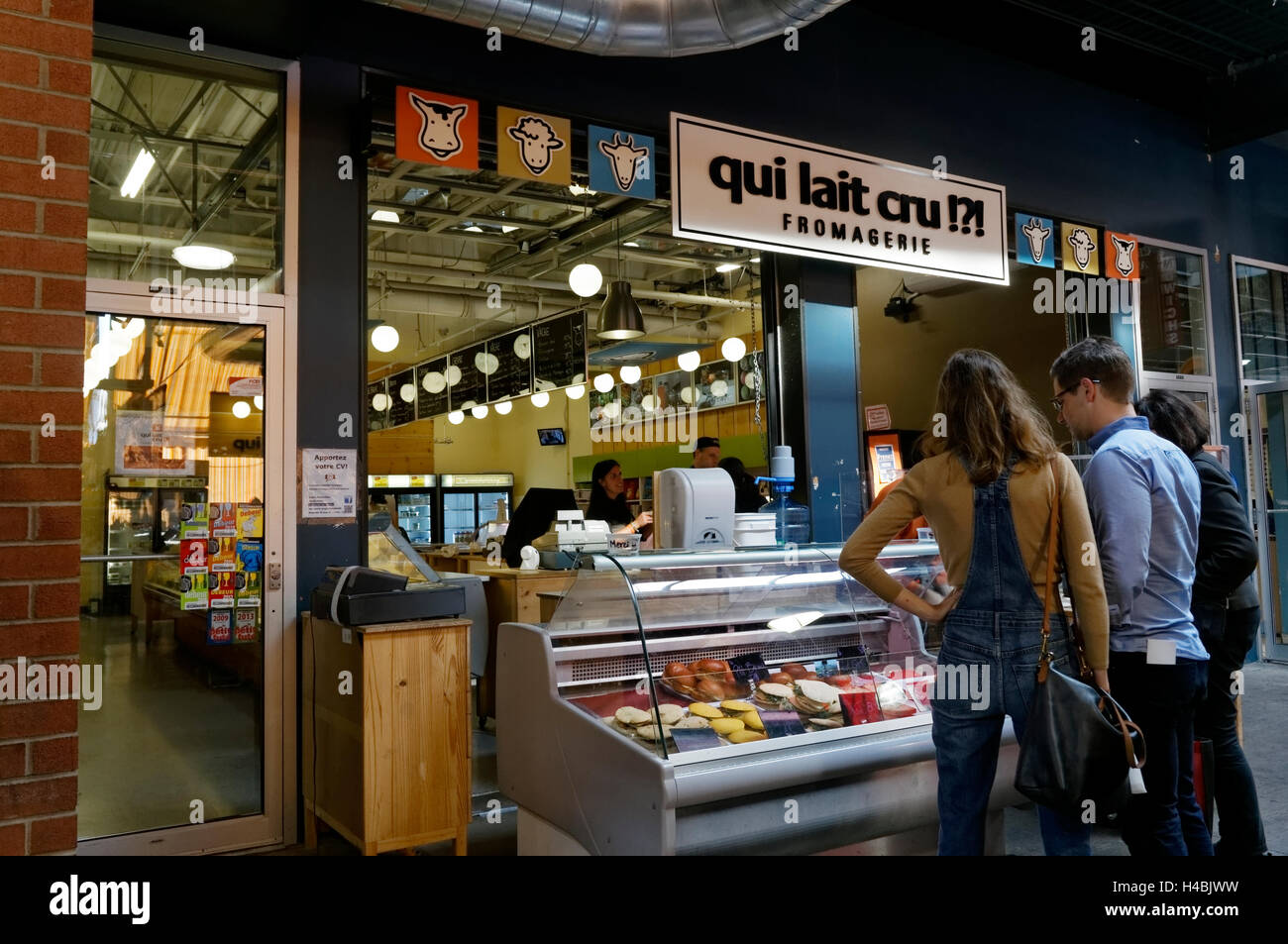 People at a cheese shop or fromagerie at the Jean Talon Market, Montreal, Quebec, Canada - Stock Image