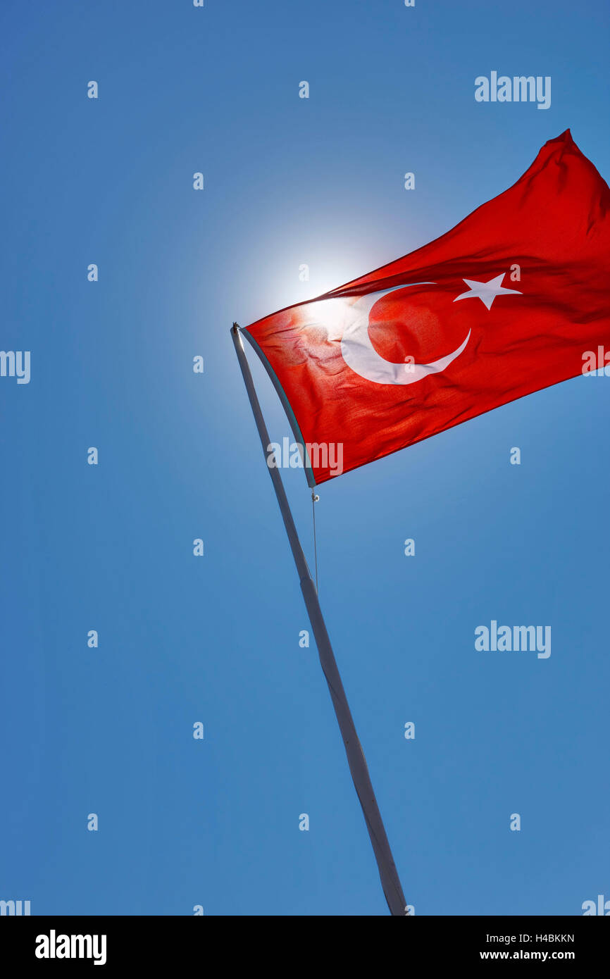 Flag waves in the wind, the sun shines through the flag, - Stock Image