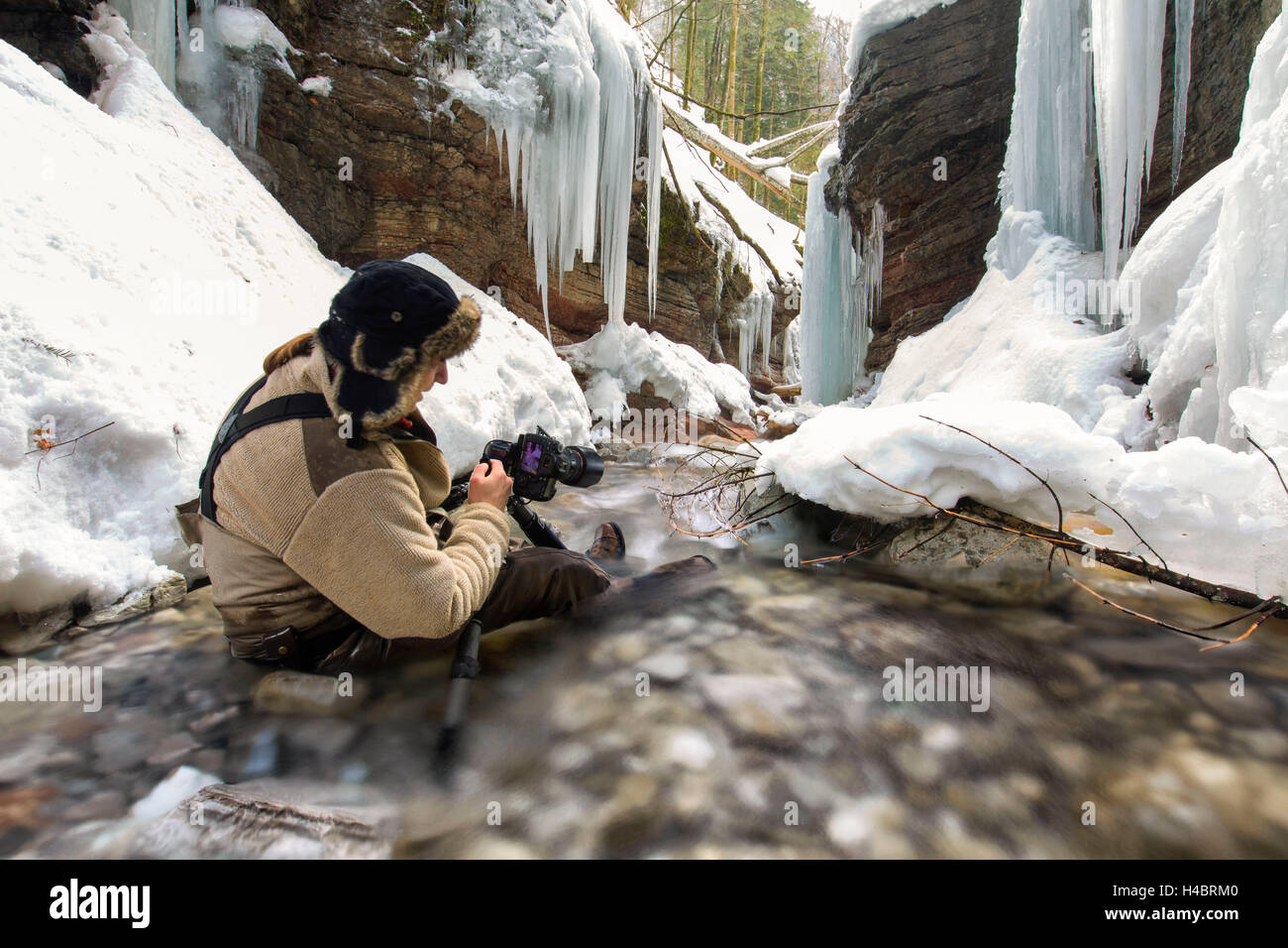 Photographer at the Taugl in winter, waterfall, Salzburg, Austria Stock Photo