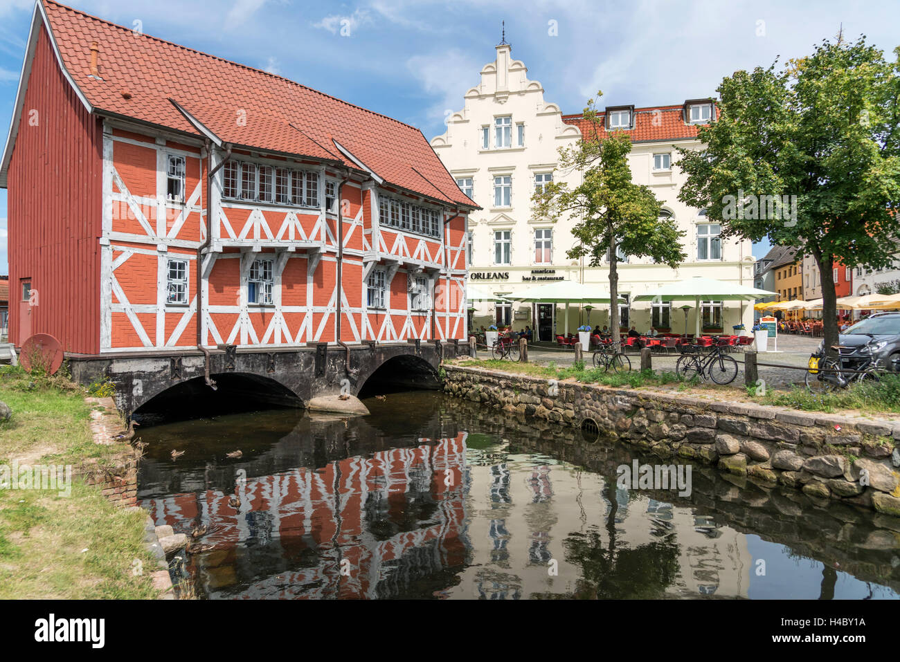half-timbered building over the Grube river or Mühlenbach,  historic old town, Hanseatic City of Wismar, Mecklenburg - Stock Image