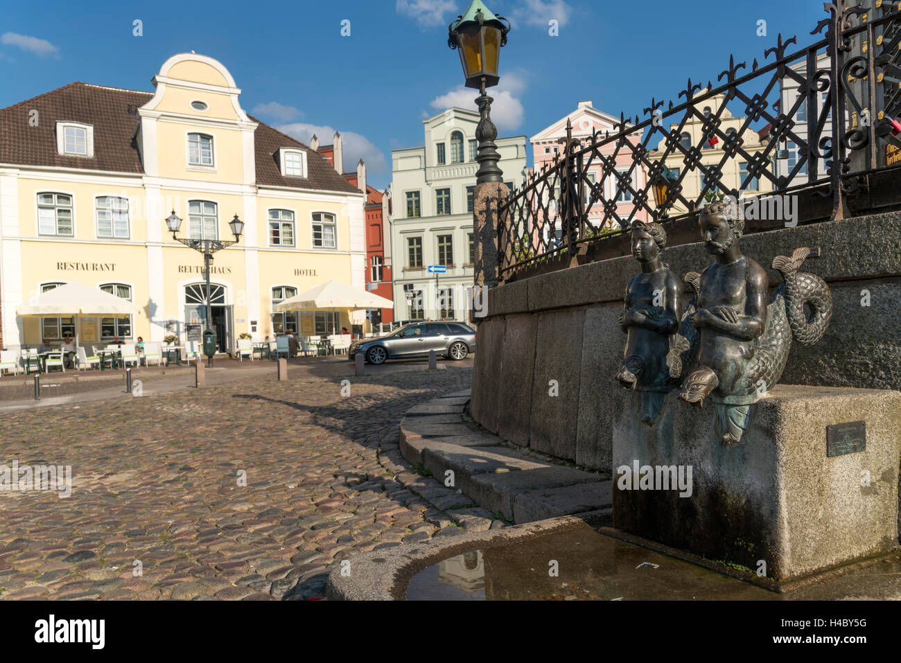 bronce statues 'Nix und Nixe' at the landmark waterworks or Wasserkunst, Hanseatic City of Wismar, Mecklenburg - Stock Image