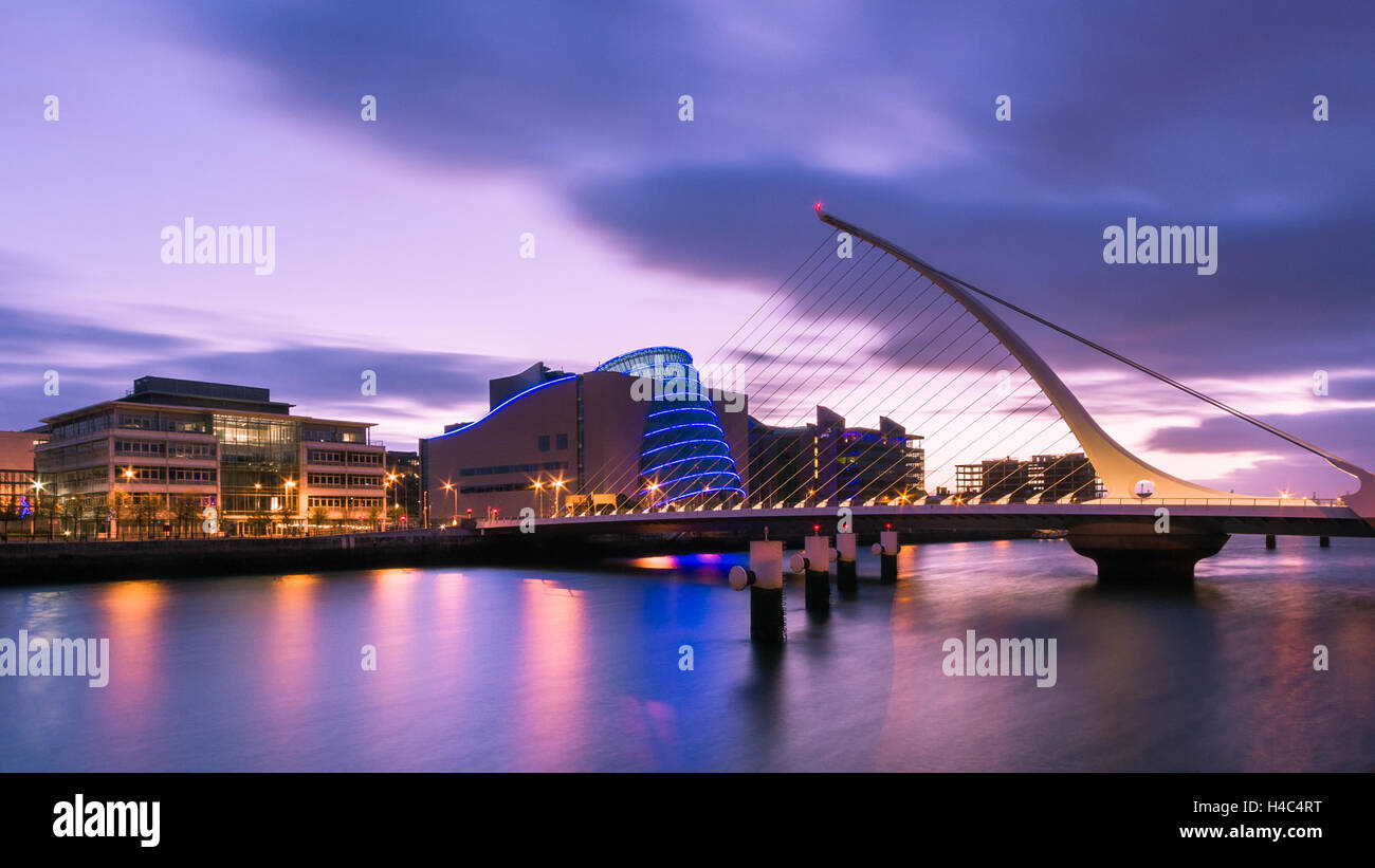 sunrise on samuel beckett bridge in dublin ireland stock photo