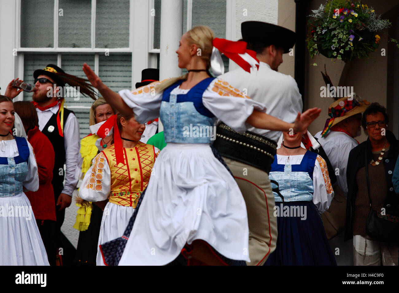 Folk dancers dancing during an annual  folk festival in Tenterden, Kent, England Stock Photo
