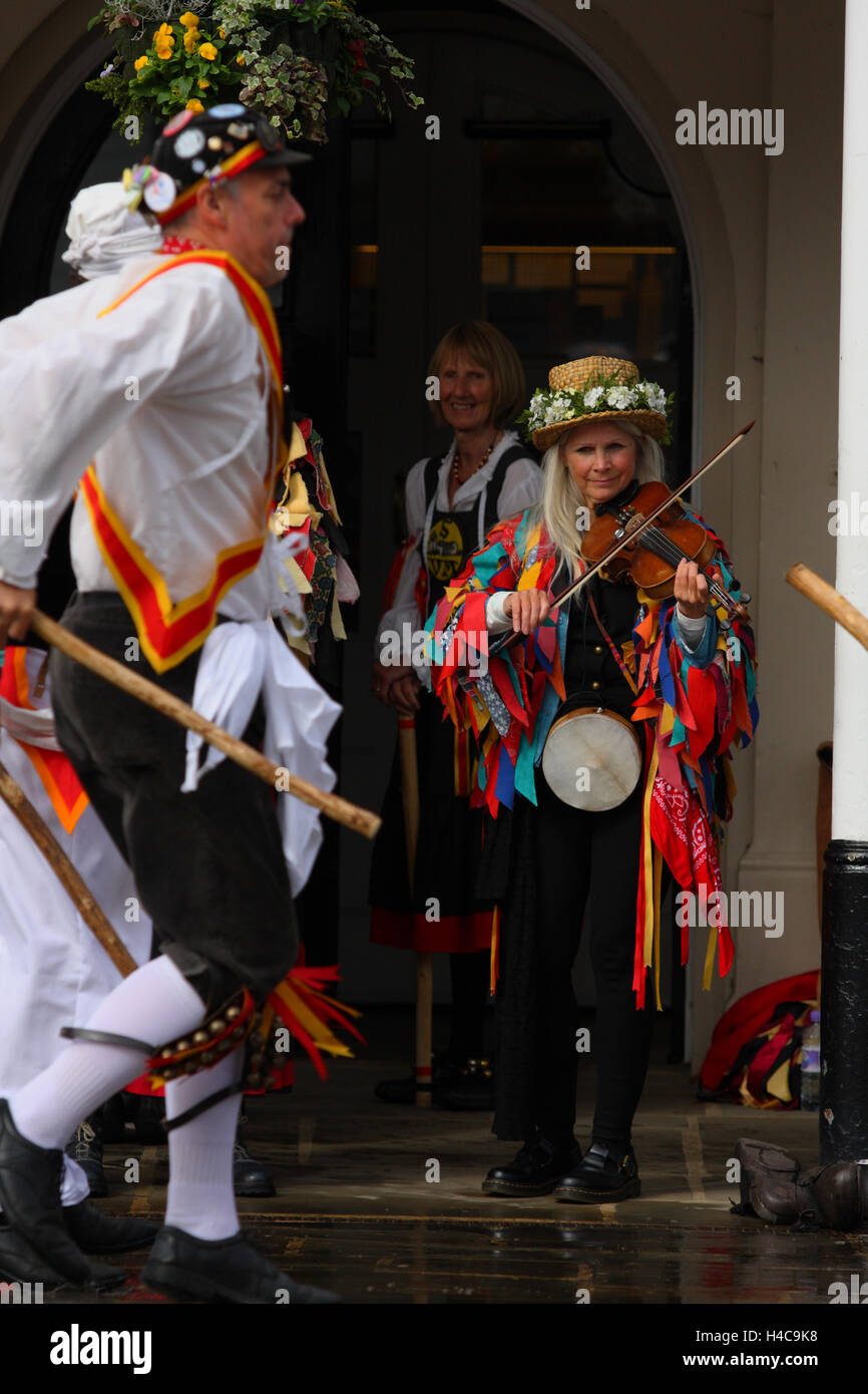 Folk dancers and a musician in action during an annual  folk festival in Tenterden, Kent, England Stock Photo