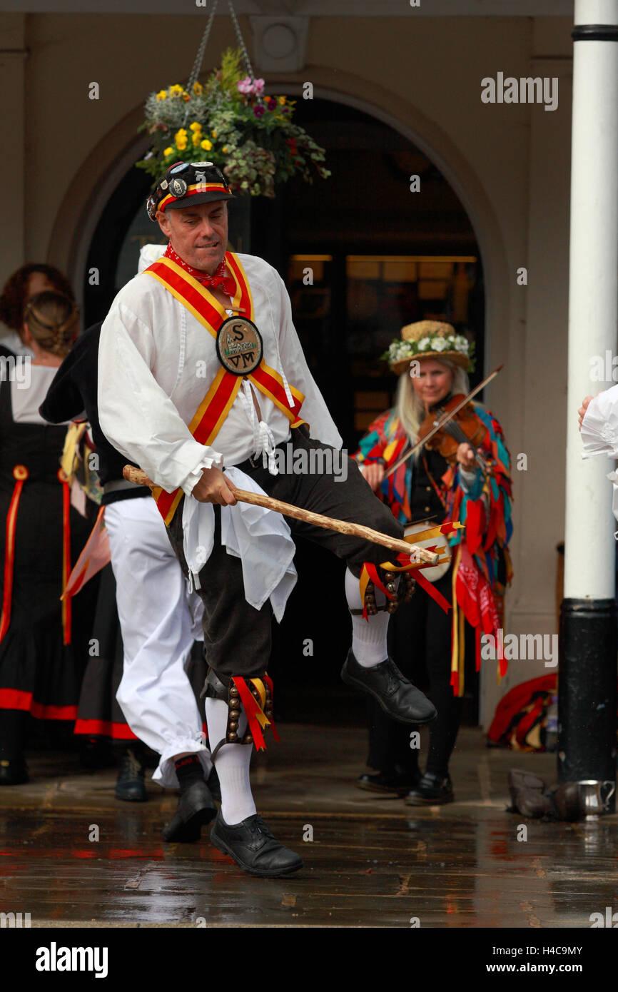 Folk dancers dancing during an annual  folk festival in Tenterden, Kent, England Stock Photo