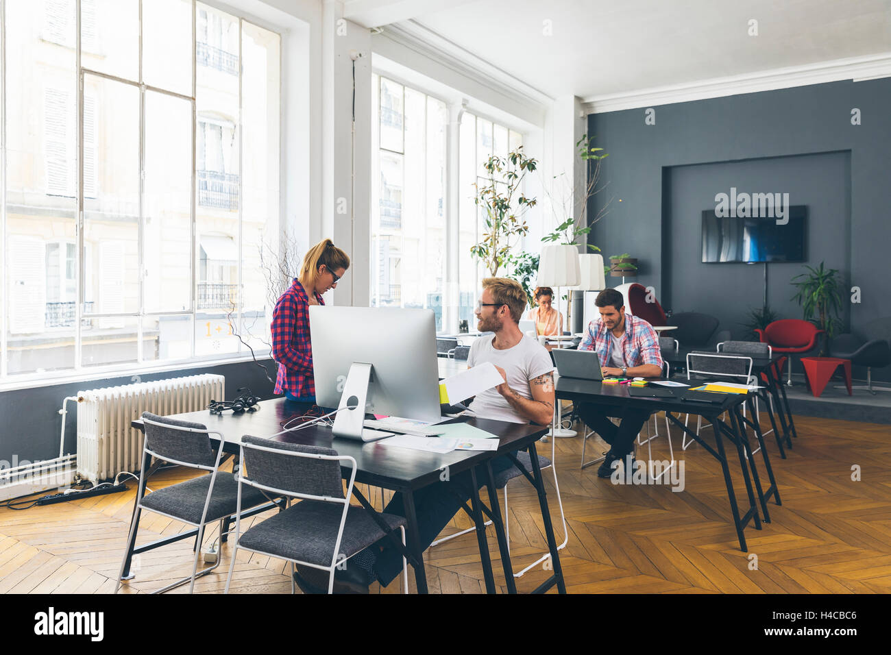 Young business people working at office on new project - Stock Image