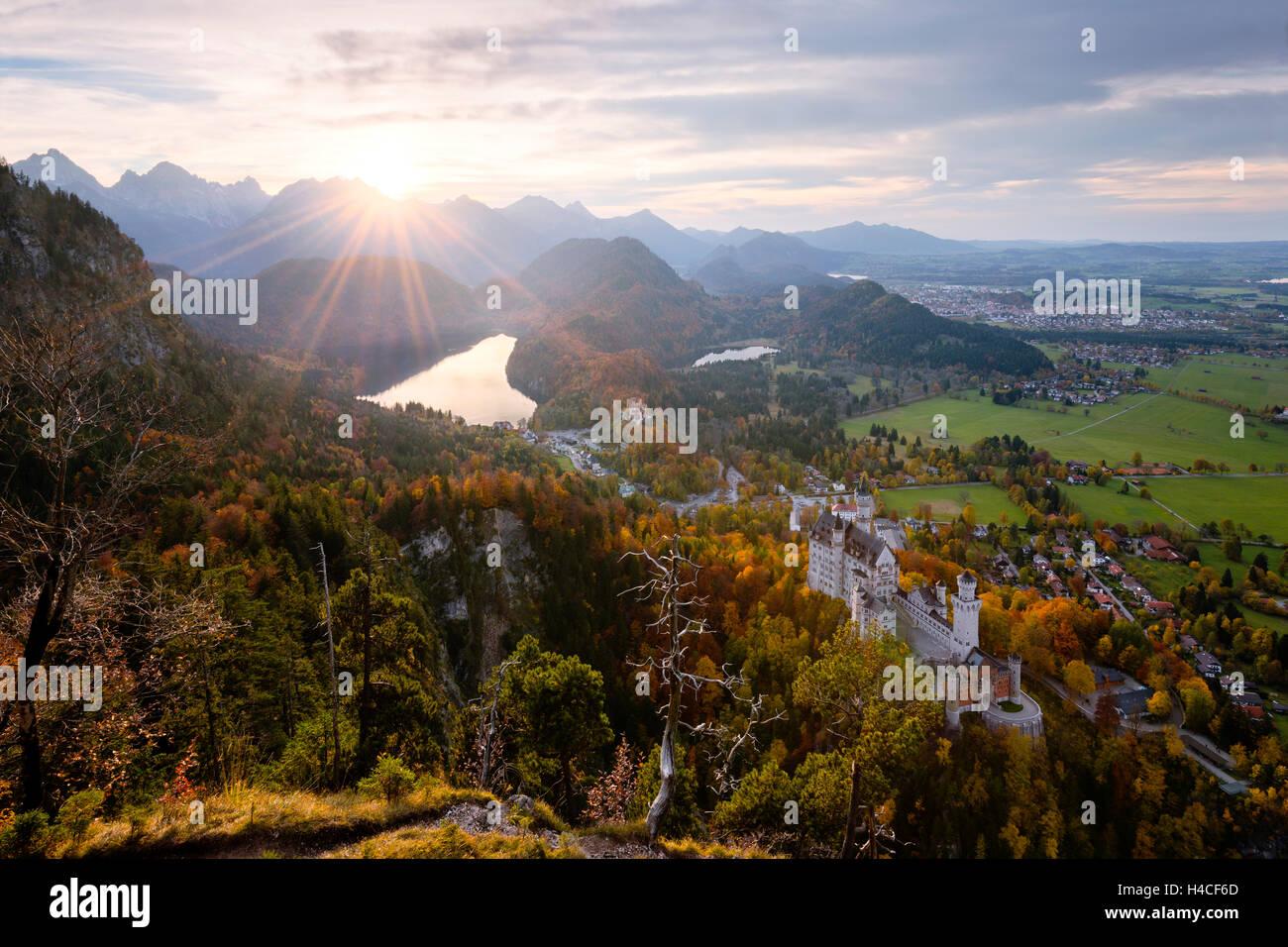 Germany, Bavaria, castle, Neuschwanstein, sun, back light, mountains, Alps, royal castle, fairy tale king, Ludwig, - Stock Image