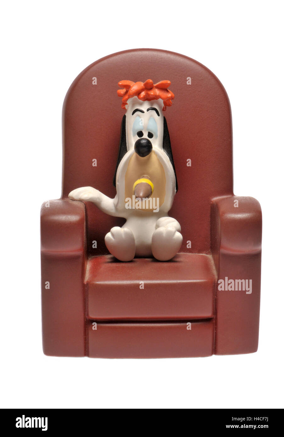 Cartoon character figurine - Droopy (MGM) sitting in an armchair, smoking A CIGAR - Stock Image