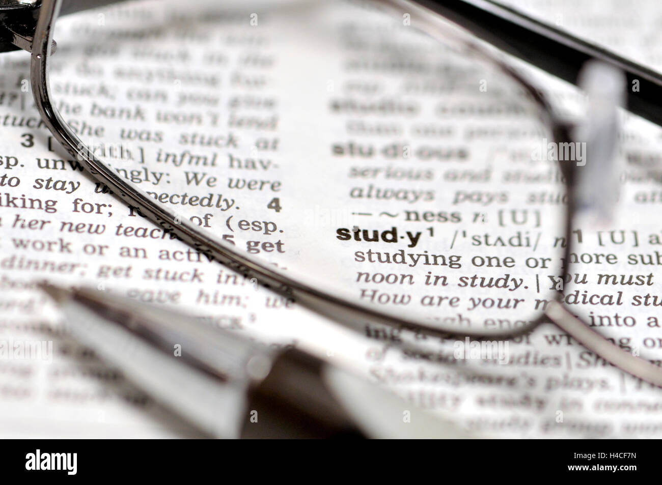 'Study' concept - dictionary, glasses and pen - Stock Image