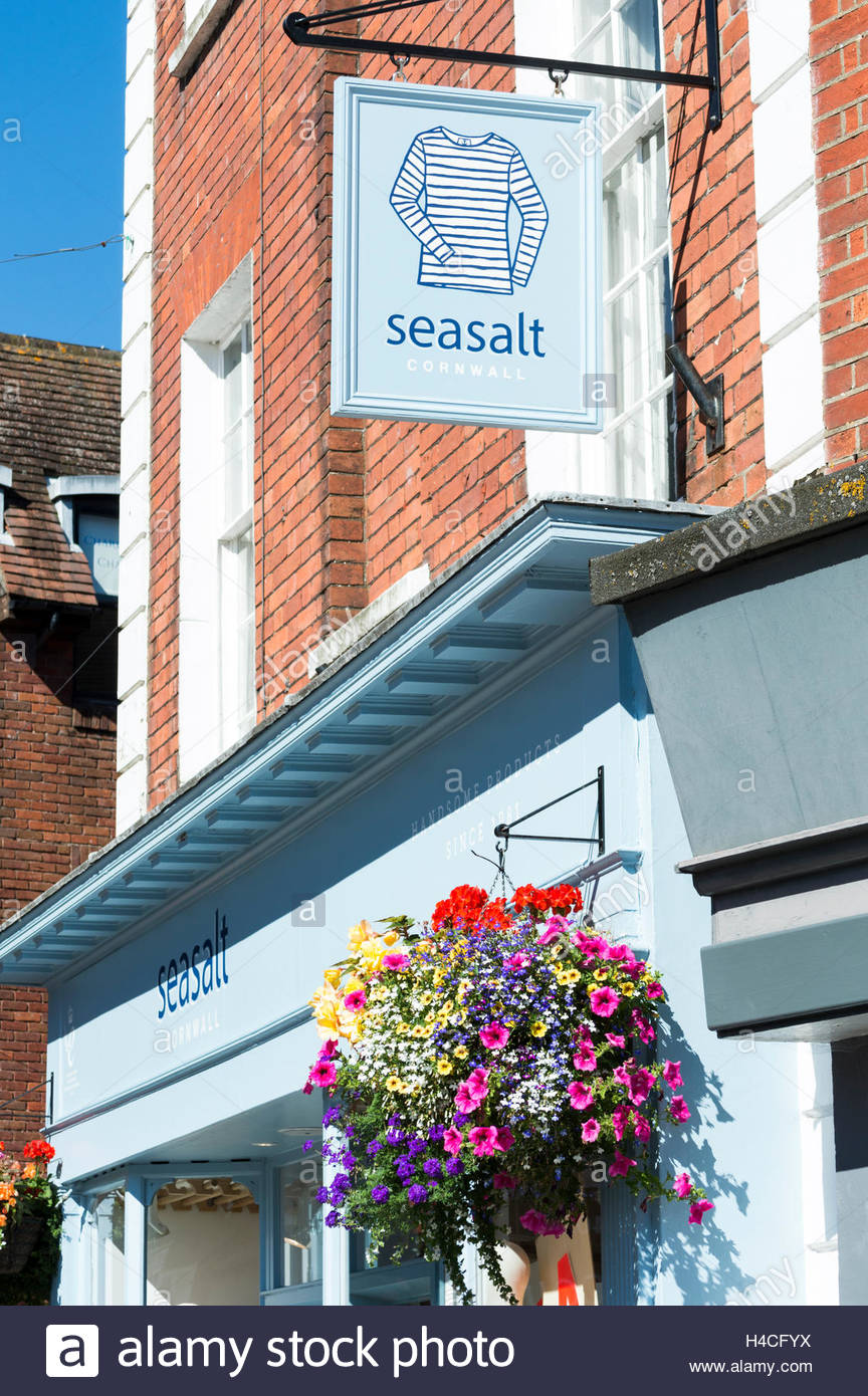 Hanging basket and Seasalt sign above the shop in Wimborne, Dorset, England - Stock Image
