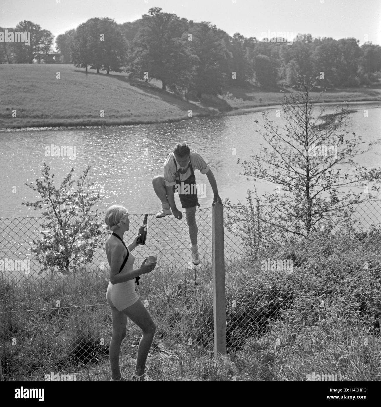 Woman Climbing Over Fence Black And White Stock Photos Images Alamy