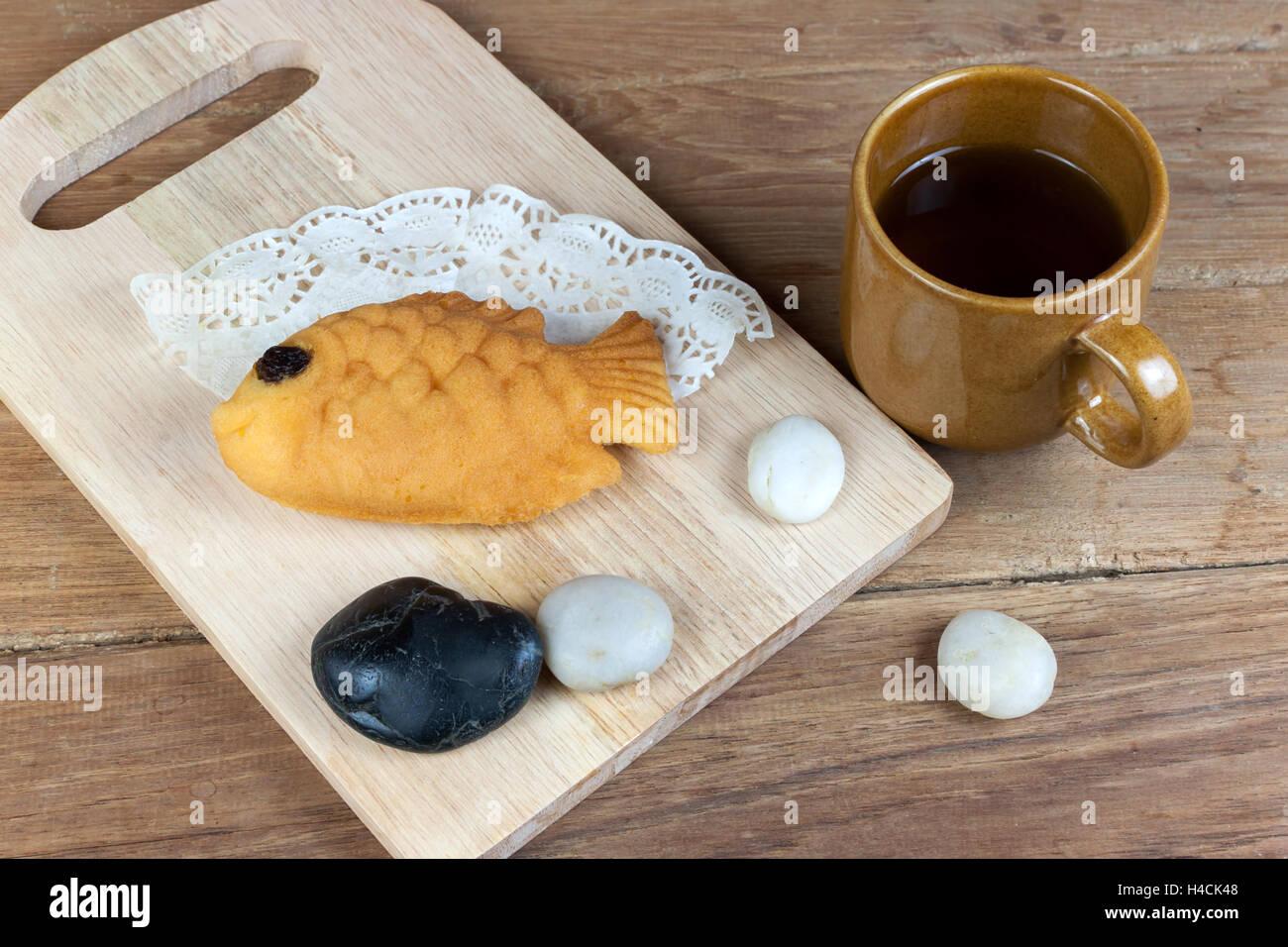 Taiyaki, Japanese Fish Shaped Pancake. Eaten With Hot Tea On Wood Table
