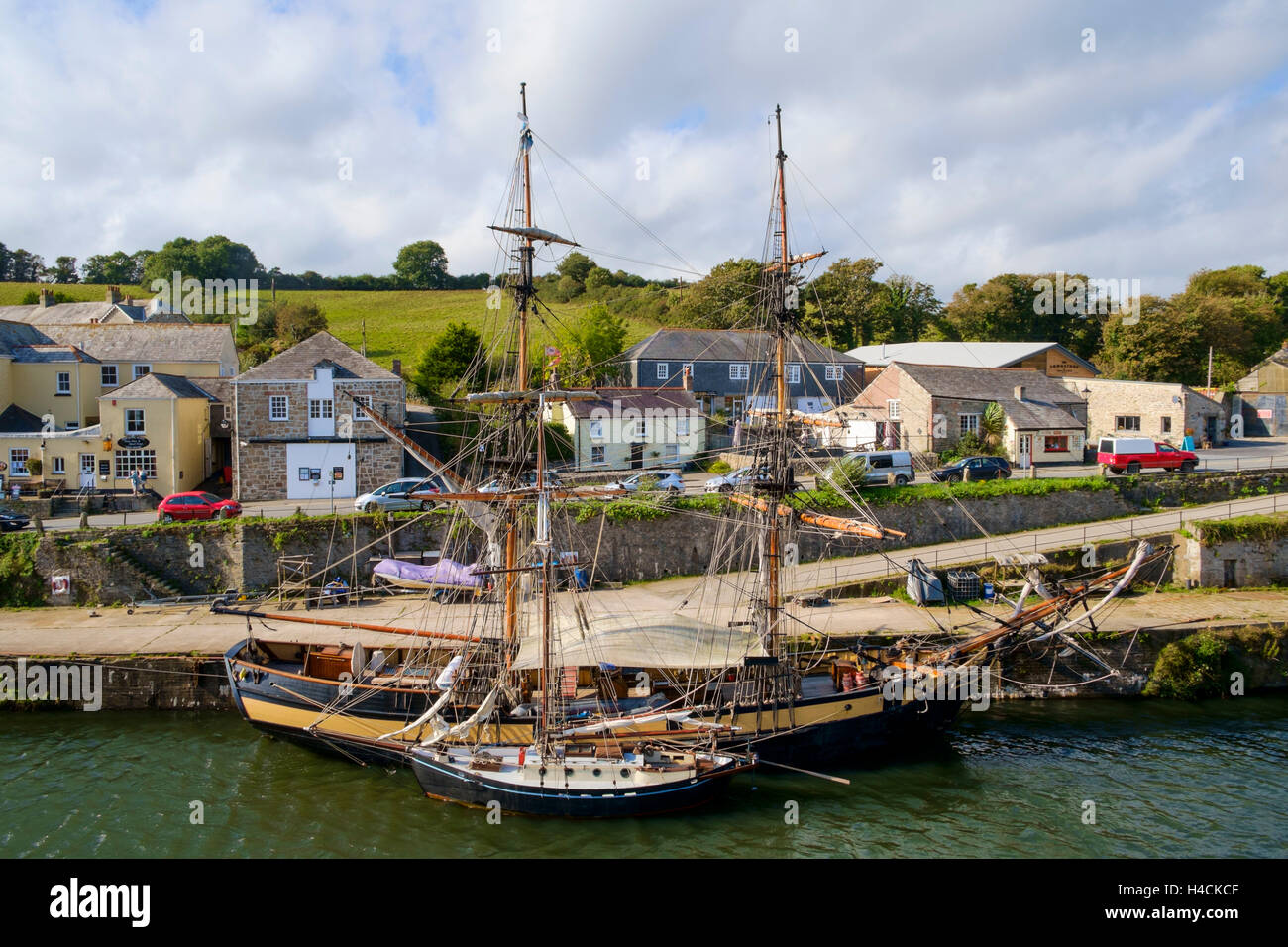 Tall ships moored in Charlestown village harbour, Cornwall, England, UK - Stock Image