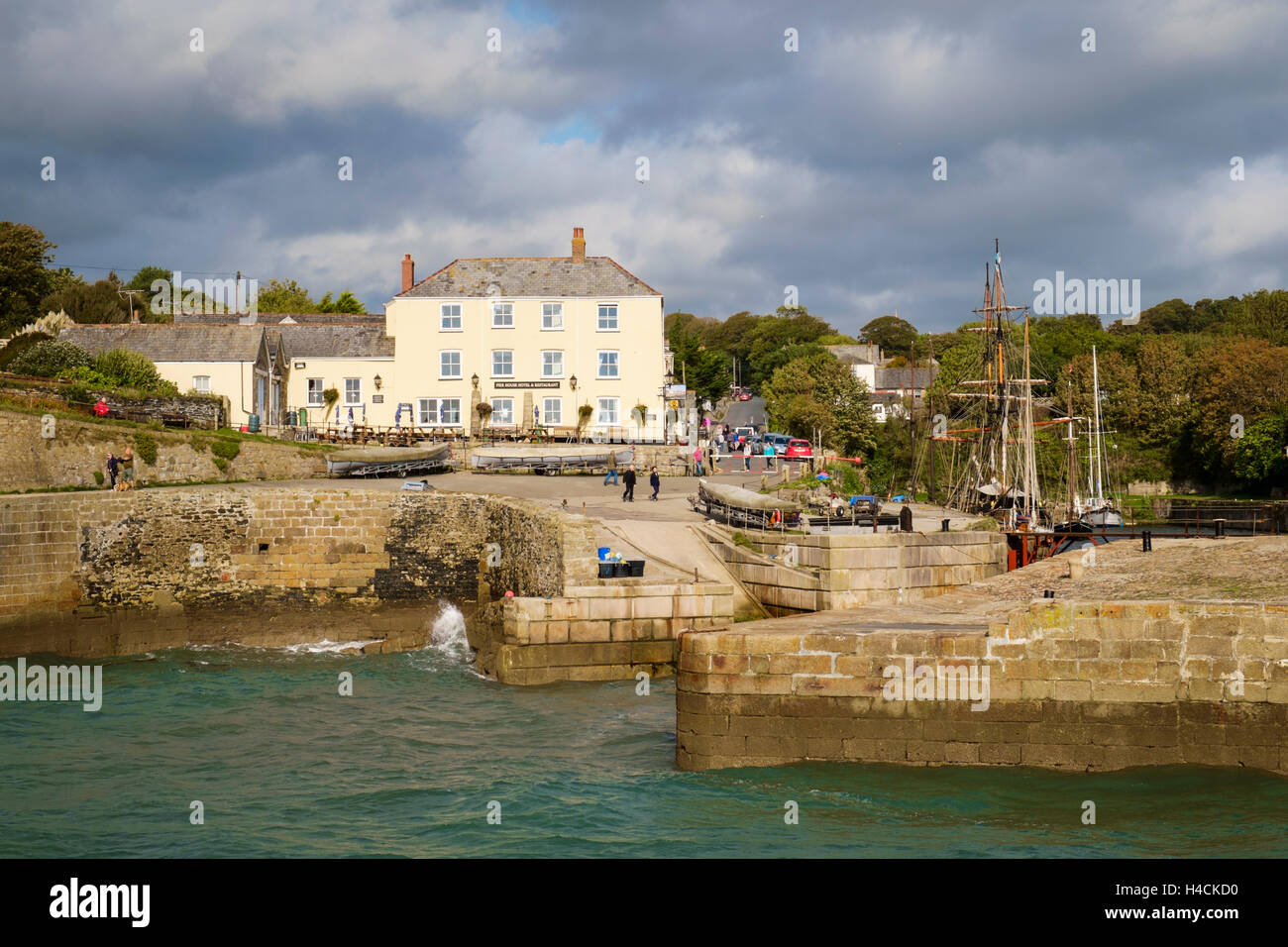 Charlestown harbour and pub, Cornwall, England, UK - Stock Image