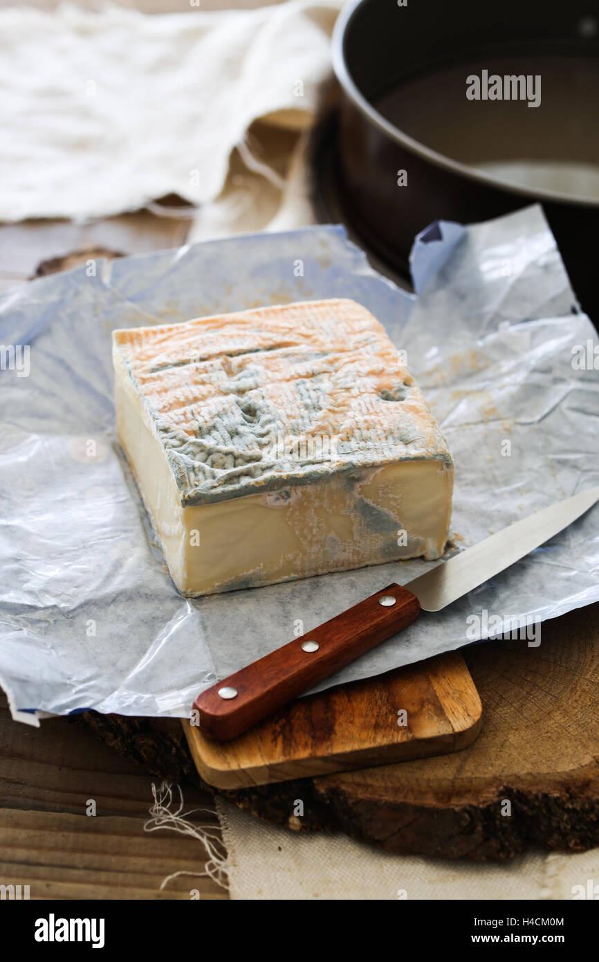 Taleggio cheese slices - Stock Image