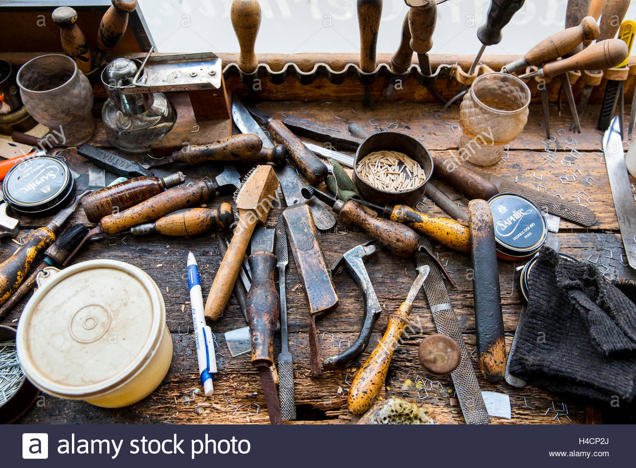 Occupational report with shoemaker Klemann Shoes - Stock Image