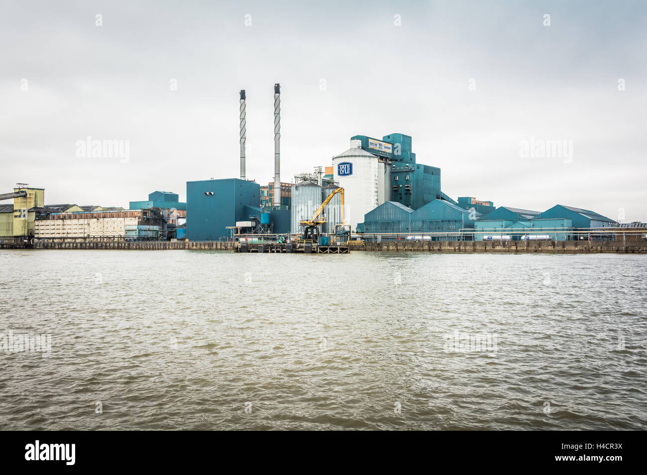 The Tate and Lyle sugar refinery in Silvertown near London City Airport, UK - Stock Image