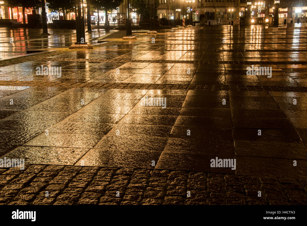 big square in the city with bright reflection light at a rainy night - Stock Image