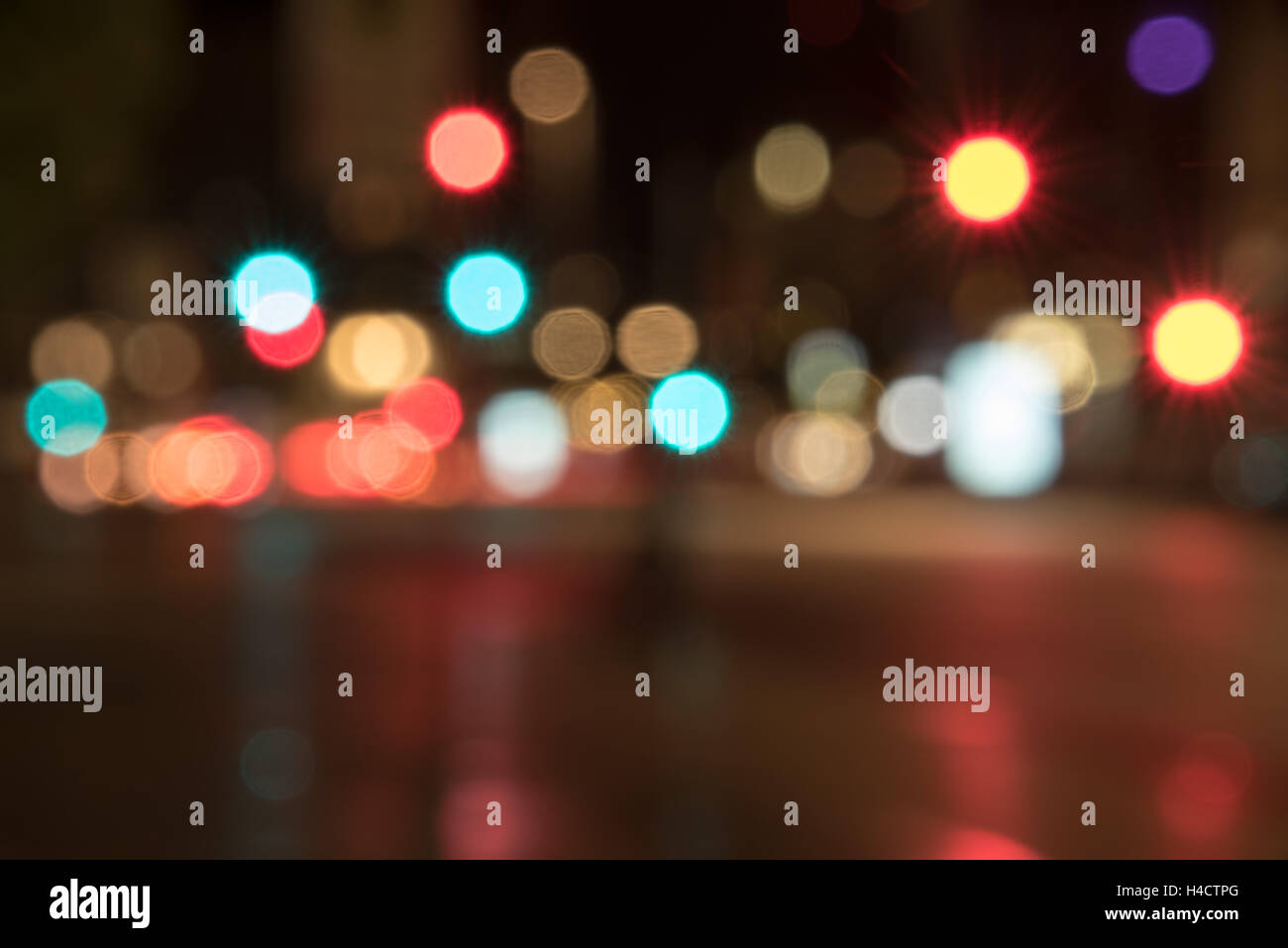 blurred street with bokeh of colored traffic lights - Stock Image