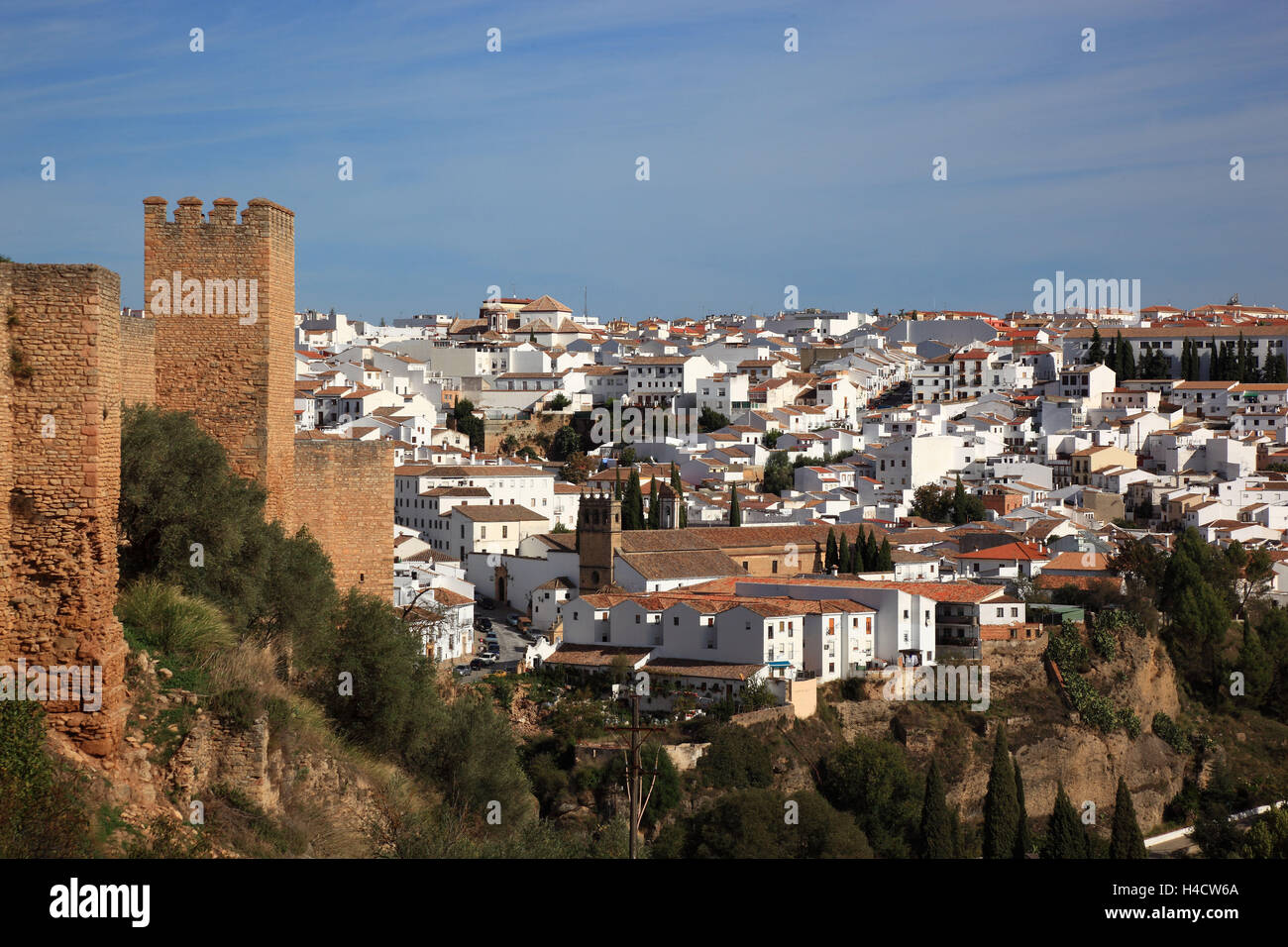 Ronda, of a white village in Andalusia, Spain, part the city wall and view at the town - Stock Image