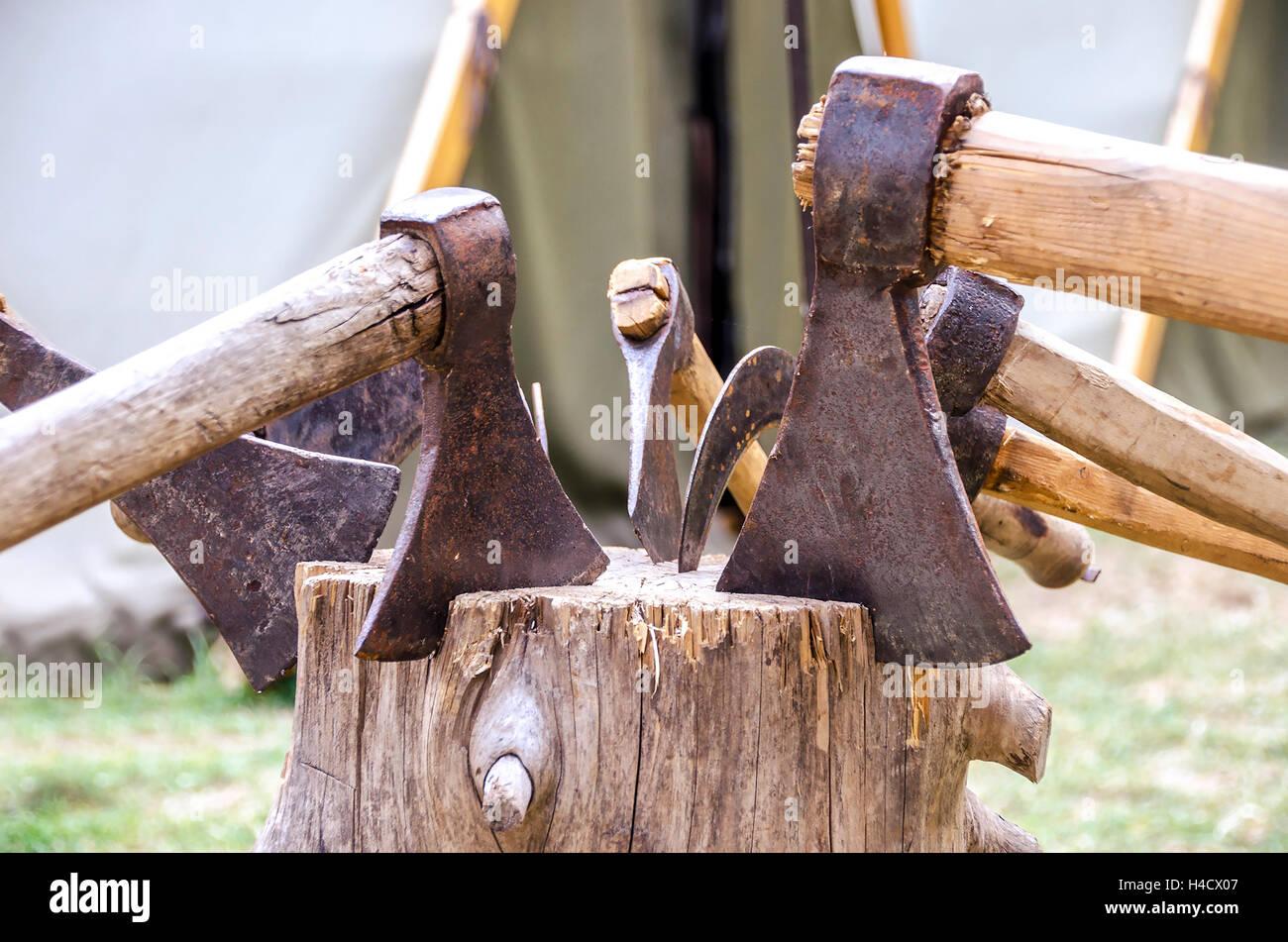 axes firewood woodcutter stump log stub - Stock Image
