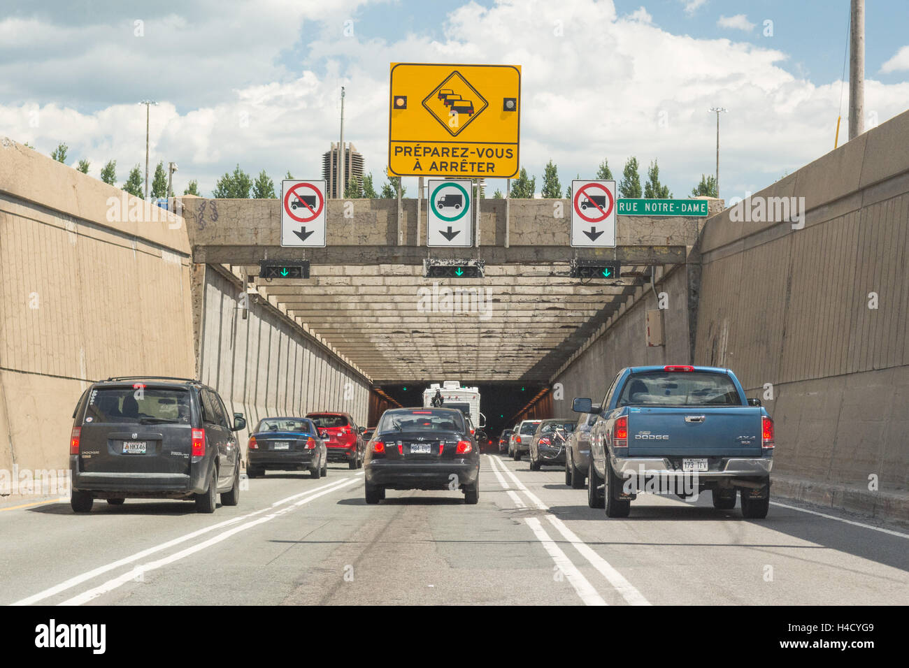 La Fontaine Tunnel - cars on autoroute 25 passing under the Saint Lawrence River, heading eastbound, Montreal, Quebec, - Stock Image