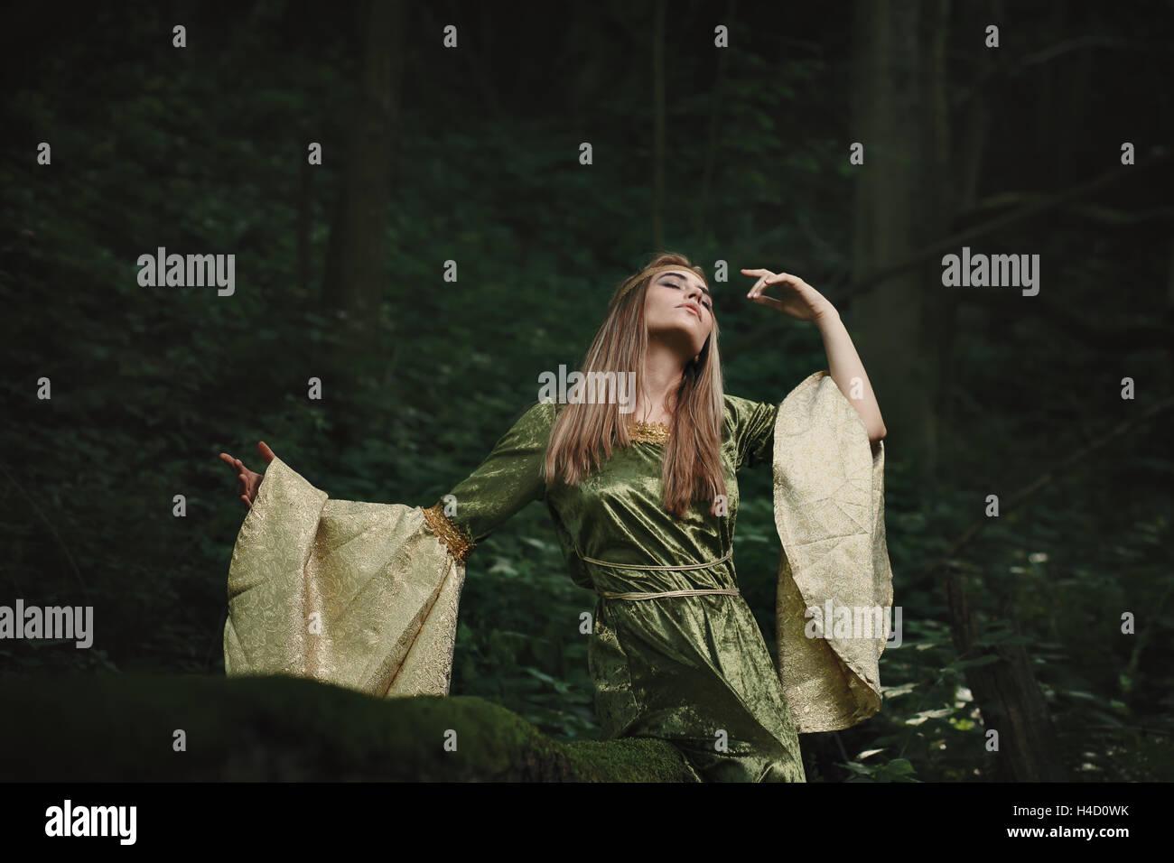 Elfin queen dancing in magical woods. Fairytale and fantasy - Stock Image