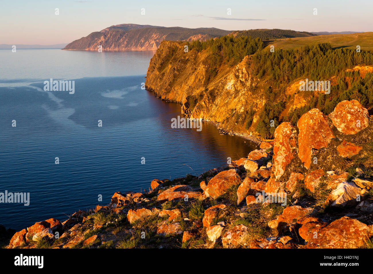 Sunset view of coastline and cape 'Three brothers' of Olkhon island on Baikal lake, Russia - Stock Image