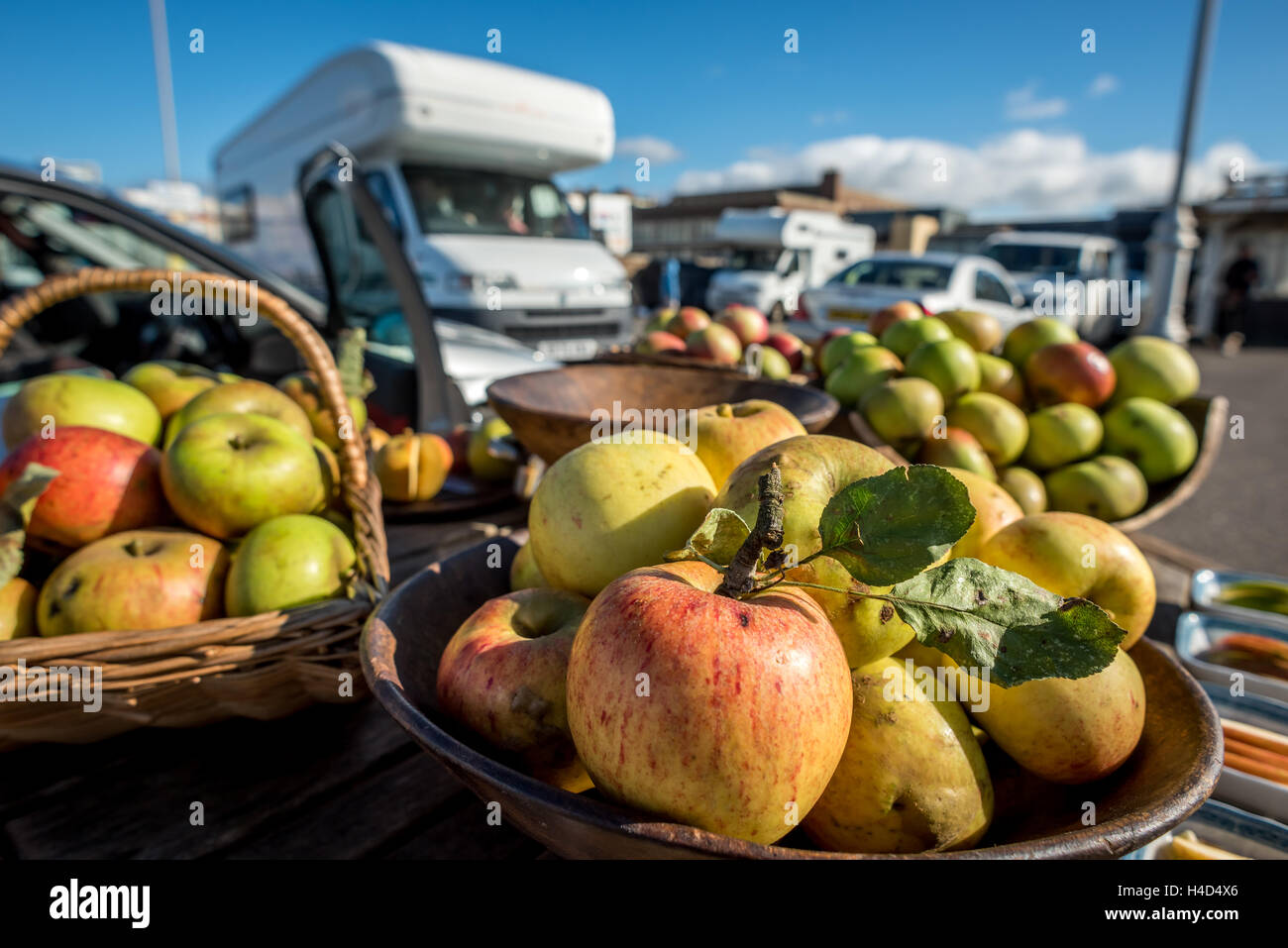 A man selling apples on Brighton seafront. - Stock Image