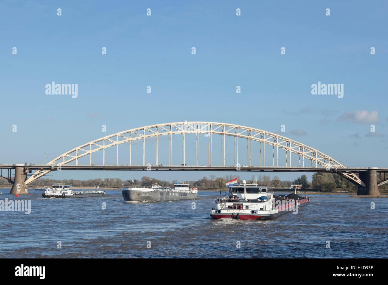 Inland ship with coal charge on the Waal with street bridge Waalbrug, Nijmegen, monetary country, the Netherlands - Stock Image