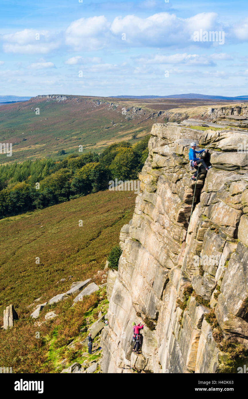 Climbers on Stanage Edge Peak District Derbyshire England UK GB EU Europe - Stock Image