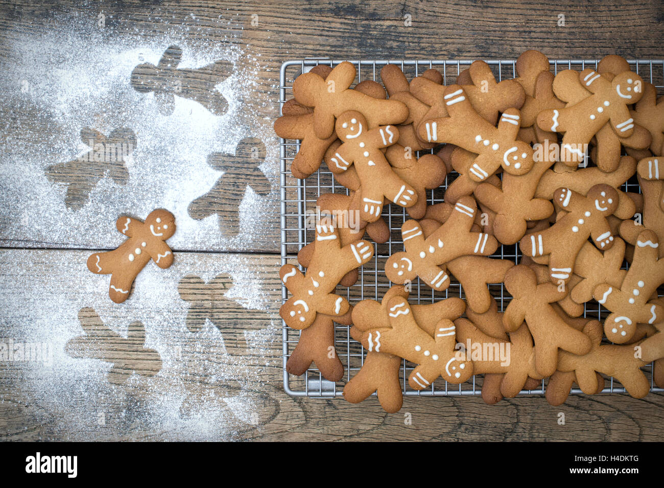 Gingerbread Men biscuits on a wire cooling rack Stock Photo