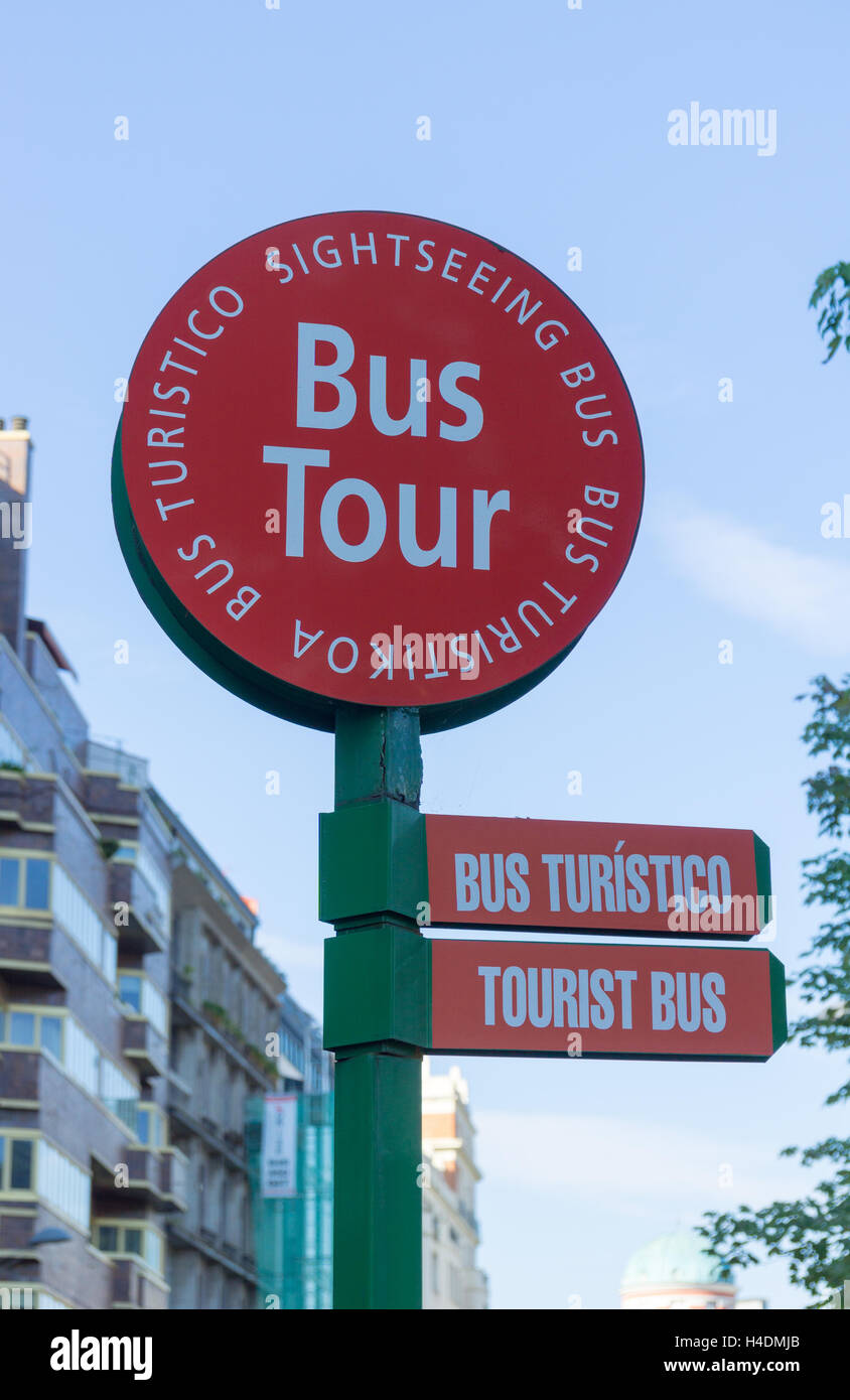 A tourist bus sign in three languages, English, Spanish, Euskera - Stock Image