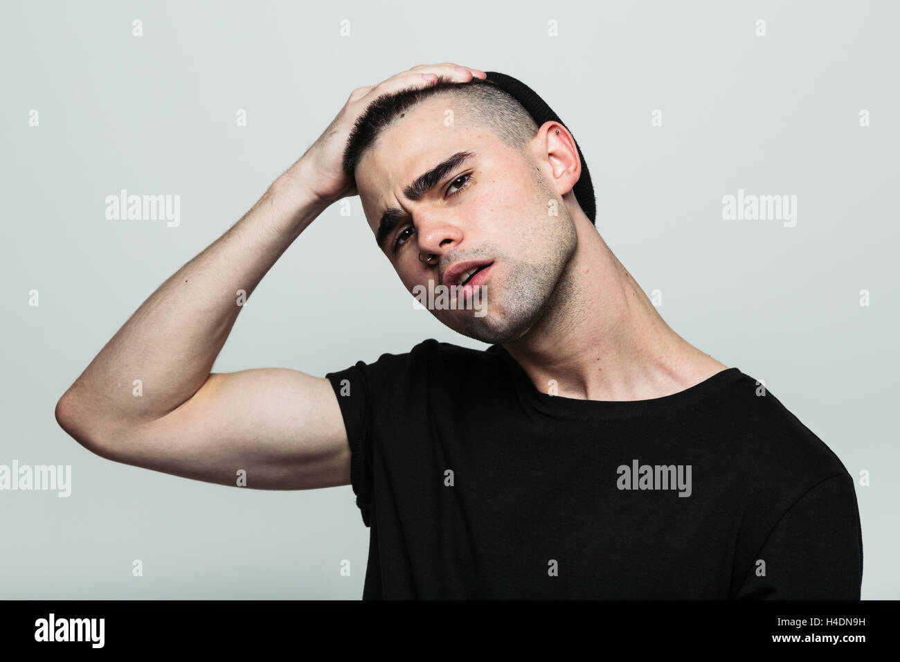 Man gather his brows. - Stock Image