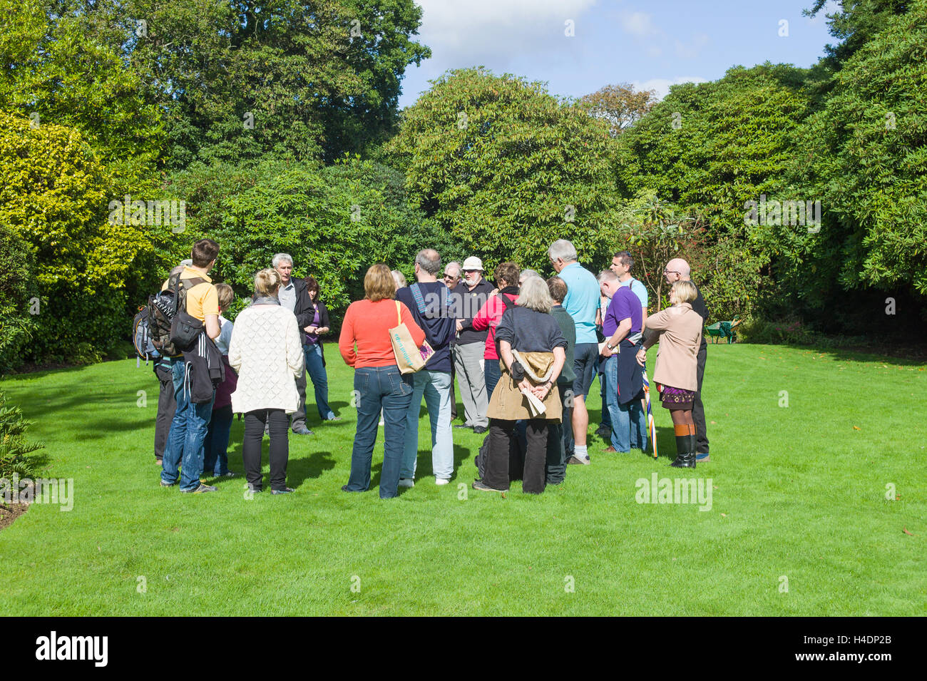 Garden guide addressing a group of visitors to the Lost Gardens of Heligan in Cornwall - Stock Image