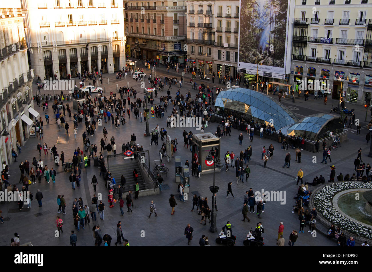 Puerta del Sol, hundreds of people mill around the plaza in the late afternoon. Stock Photo