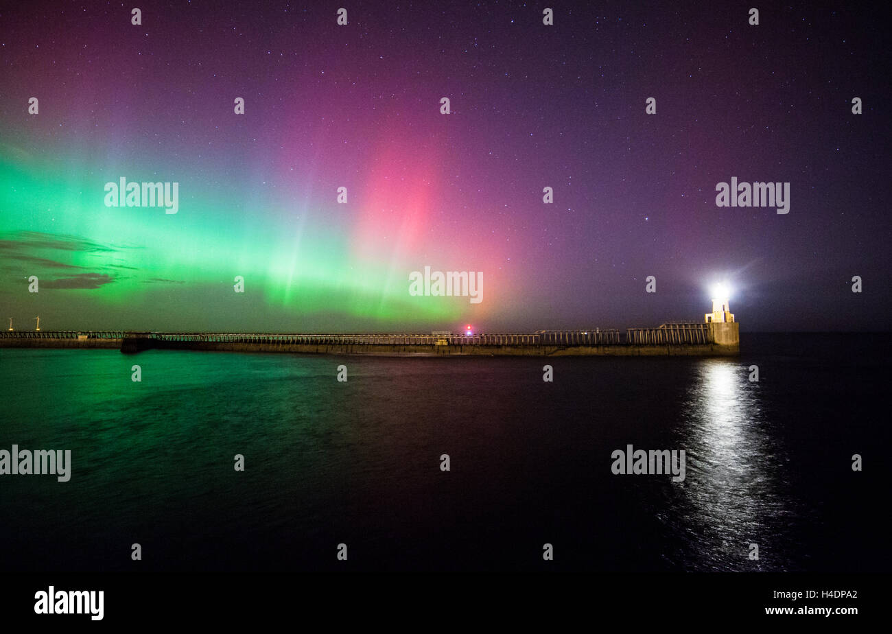 Aurora Borealis, Northern Lights display at Blyth pier and lighthouse over Blyth harbour, Northumberland, night - Stock Image