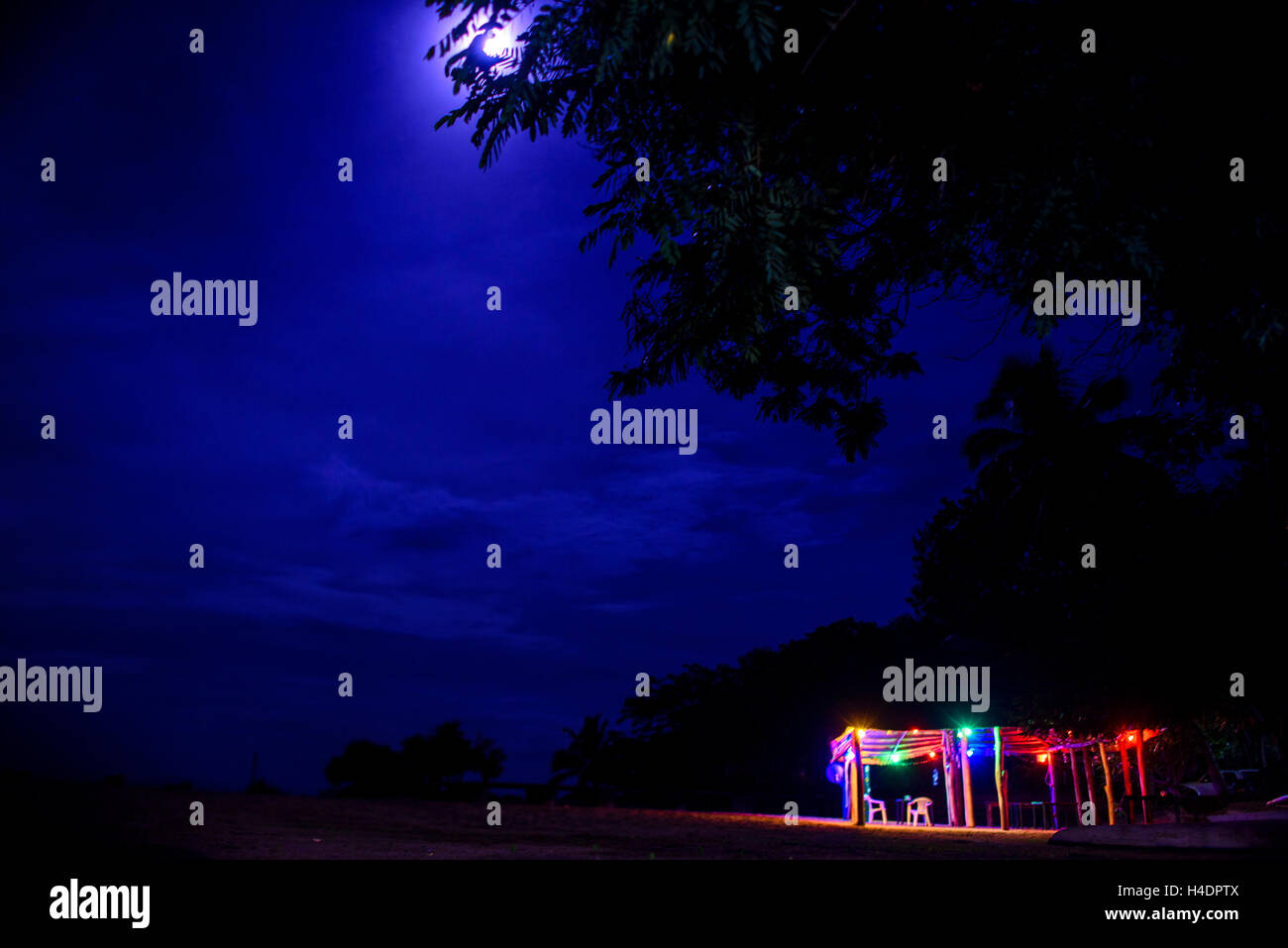 Runable aground in the moonlight in Malawi lake - Stock Image