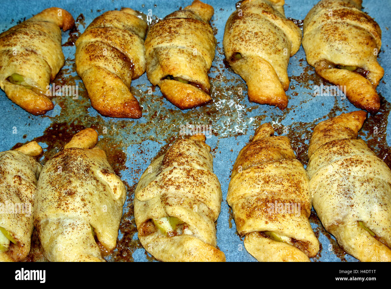 Apple cinnamon spice turnover pastries baking sheet - Stock Image