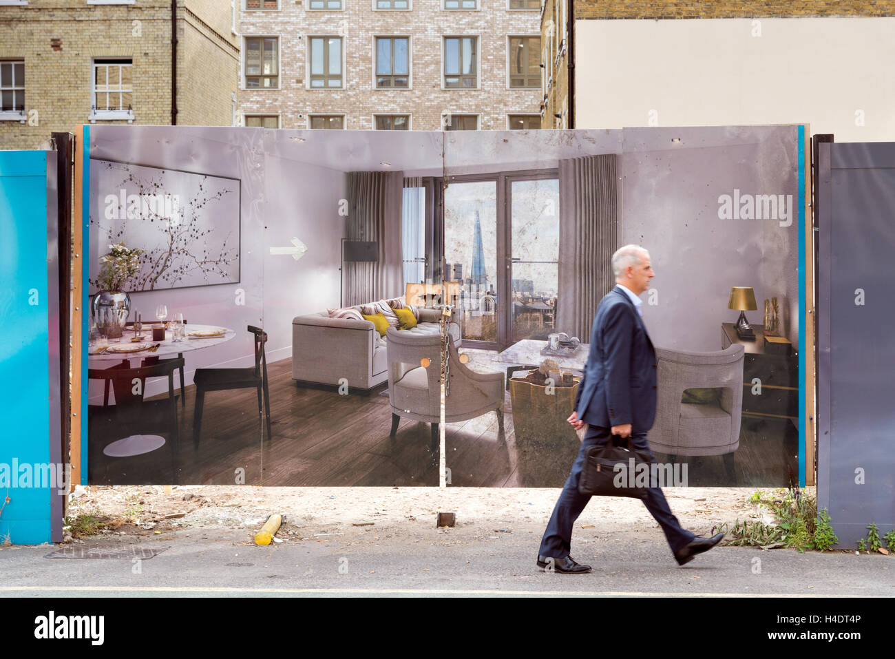 Hoarding showing the interior of new build apartments in a new property development in the City of London, England, - Stock Image