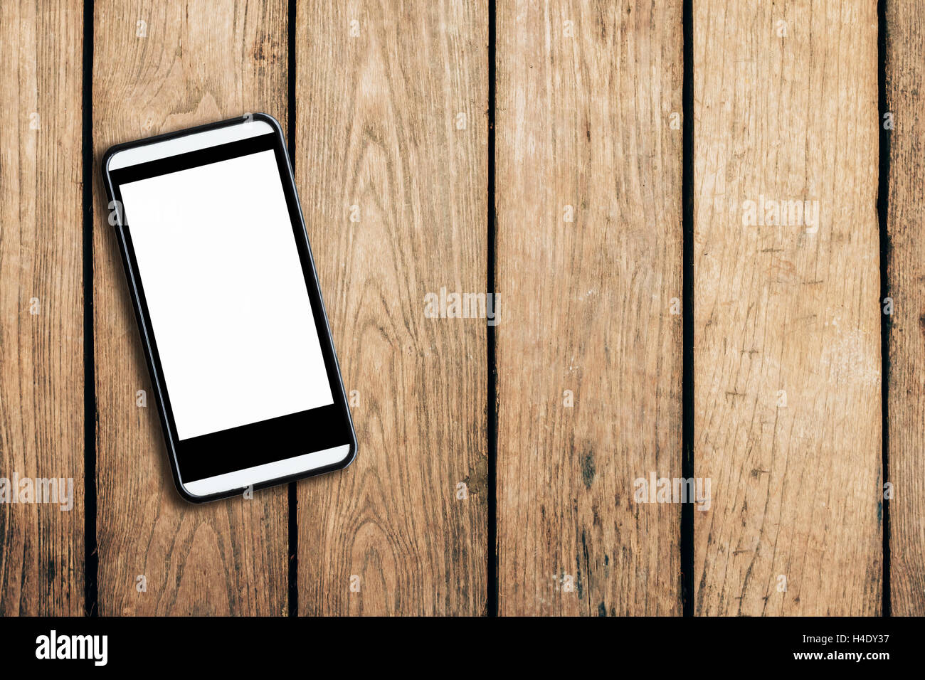 cell phone on wooden table texture background with space. - Stock Image