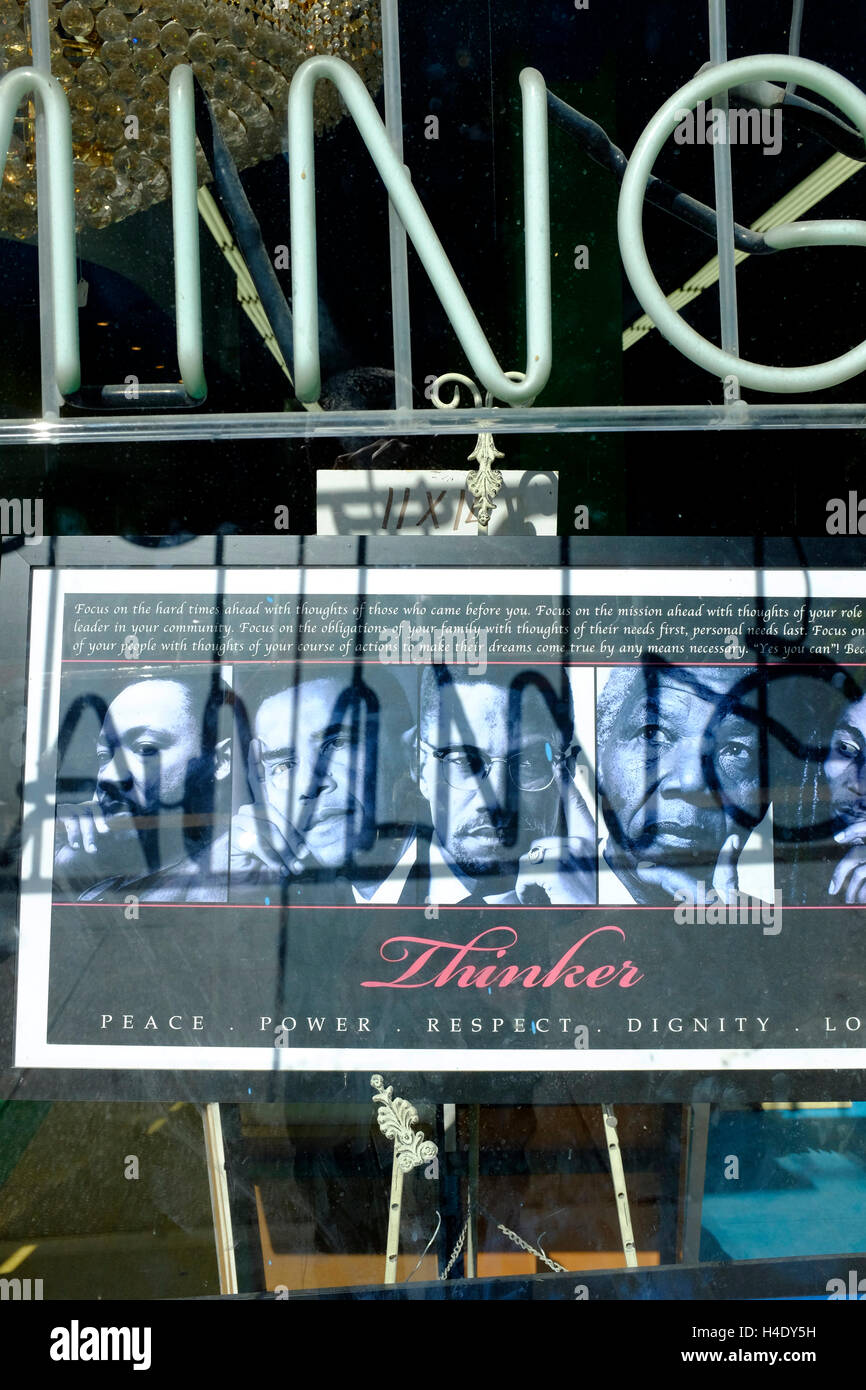 Posters of famous black thinkers display in a store window in Harlem, Manhattan,New York City.USA - Stock Image