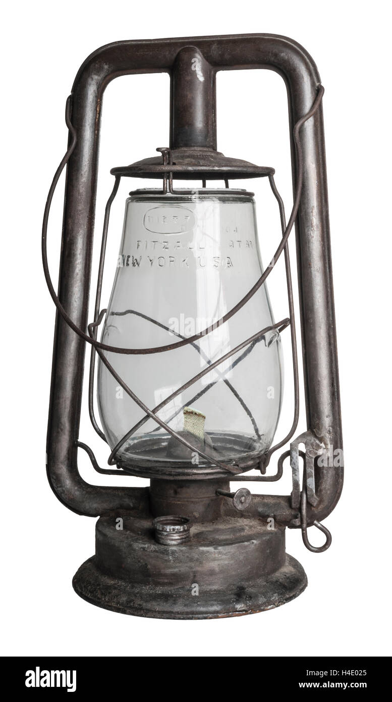 Antique oil lamp isolated over a white background - Stock Image