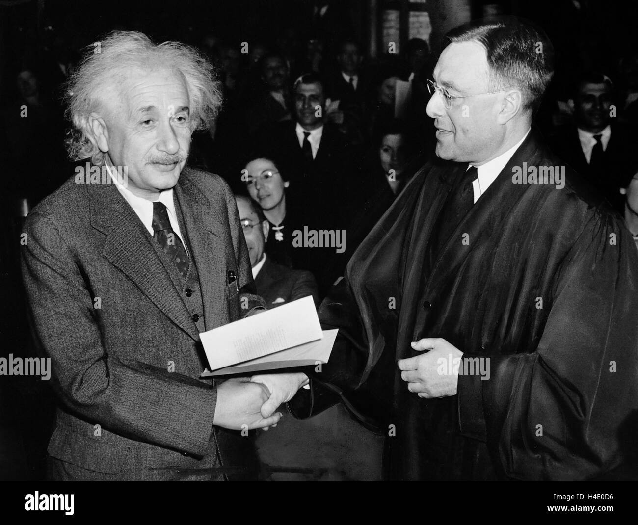 Albert Einstein (1879-1955) receiving his certificate of American citizenship from Judge Phillip Forman on October - Stock Image