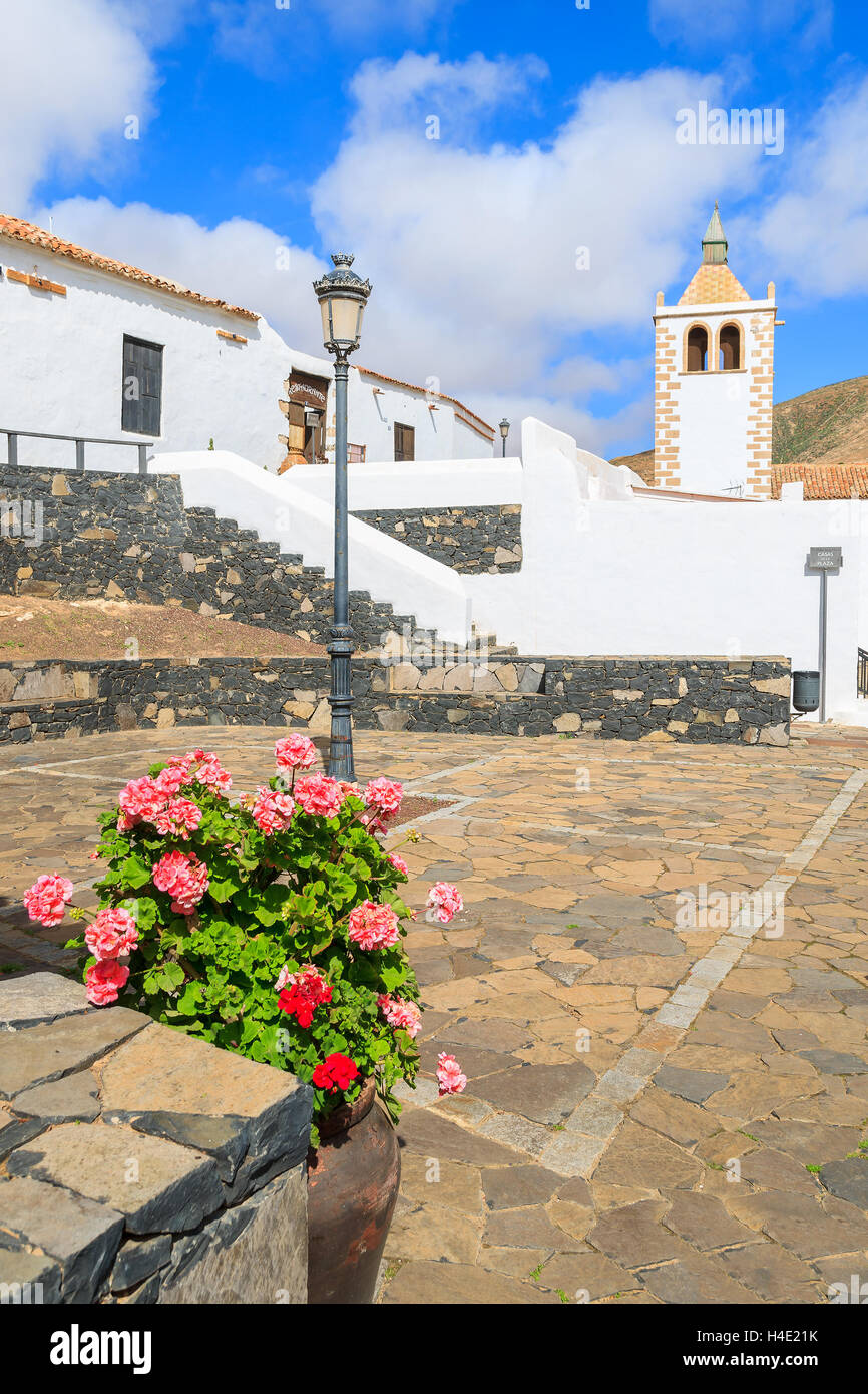 Beautiful cathedral Santa Maria de Betancuria and flower pot in foreground Fuerteventura, Canary Islands, Spain - Stock Image